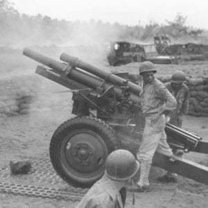 "One of the twelve 105-mm howitzers of Wilber's battalion (152nd Field Artillery) firing ""over the American perimeter,"" Aitape, New Guinea, August 4, 1944. [Photo : U.S. Army Signal Corps, SC 267974]"