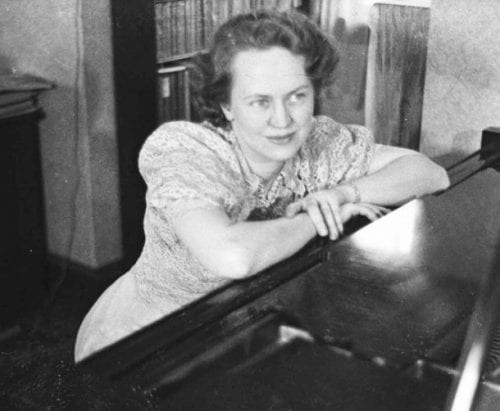 Norma Sparlin Bradt at her new grand piano, about 1937. {Photo: Bradt family)