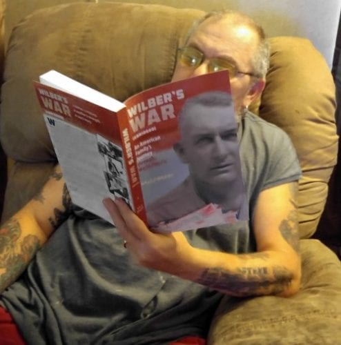 """Ms Wagg's veteran-husband reading Wilber's War. Photo: Angie Wagg."